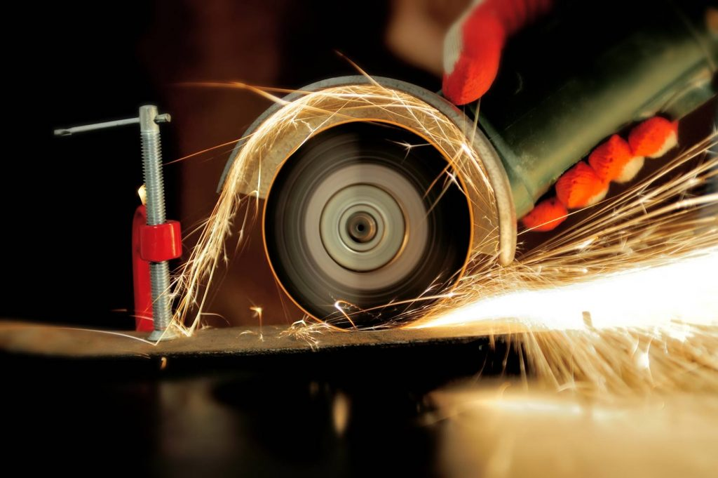 worker-cutting-metal-with-grinder