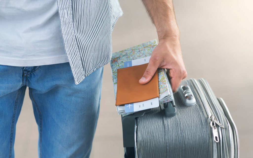 man-going-to-flight-with-suitcase-passport